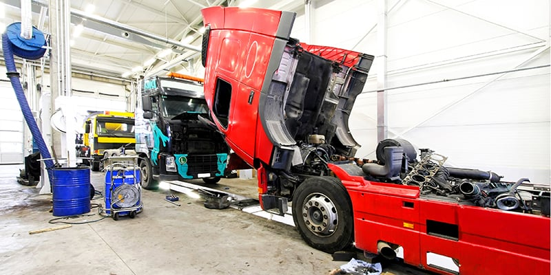 hgv getting maintenance in a garage